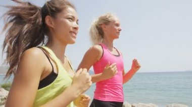 Women jogging training on beach — Stock Video