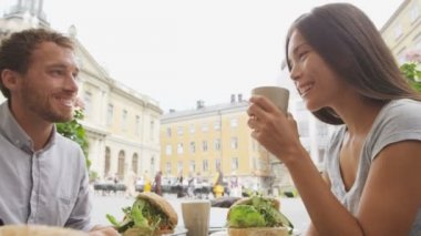 Couple eating food at Cafe in Stockholm — Stock Video
