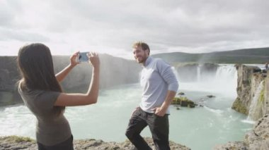 Couple taking photo with by waterfall — Stock Video