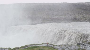 Waterfall Dettifoss on Iceland with people — Stock Video