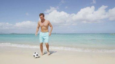 Man on beach playing football — Stock Video