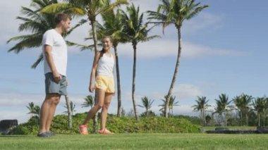 Multiracial couple in sportswear talking — Stock Video