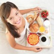 Woman having breakfast in bed — Stock Photo #69710843