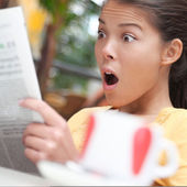 Woman shocked over shocking news — Stock Photo
