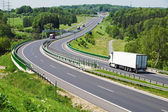 The highway between woods, in the middle of the highway electronic toll gates, moving trucks — Stock Photo