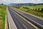 Corridor highway with the transition for animals, in the distance three red car — Stock Photo
