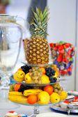 Pineapple, grapes, pears, orange and bananas — Stock Photo