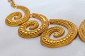 Gold necklace spiral — Stock Photo