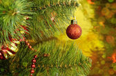 Christmas tree with red ball and tinsel — Stock Photo