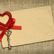 Greeting card with red ribbon and a key for Valentine's day — Stock Photo #62513993