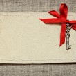 Greeting card with red ribbon and a key for Valentine's day — Stock Photo #62513881