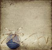 Blue christmass ball and ribbon — Stock Photo