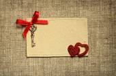 Greeting card with red ribbon and a key for Valentine's day — Stock Photo