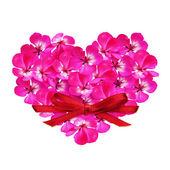 Corazón de flores y una tarjeta de — Foto de Stock