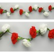 White and red carnations garlands — Stock Photo #57458919