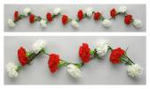 White and red carnations garlands — Stock Photo