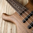 Bass guitar on aged wood — Stock Photo #59303217