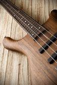 Bass guitar on aged wood — Стоковое фото