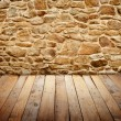 Stone wall with wooden floor — Stock Photo #64505813