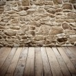 Stone wall with wooden floor — Stock Photo #64505875