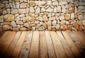 Wooden slats with stone wall — Stock Photo