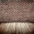 Brickwall with wooden floor — Stock Photo #68350231