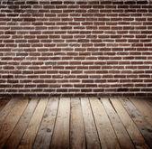 Brickwall with wooden floor — Stock Photo
