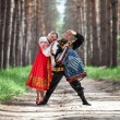 Couple on nature in russian national dress — Stock Photo #63489035