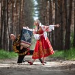 Couple of dancers in russian traditional costumes — Stock Photo #63489039