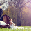 The bride and groom on the lawn in the forest — Stock fotografie #70973919