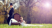 The bride and groom on the lawn in the forest — Stock Photo