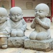 Stone statue of learning and relax Chinese monks — Stock Photo #62648013