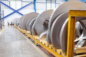 Rolls of metal sheet waiting for assembly — Stock Photo
