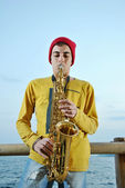 Modern musician posing with his saxophone — Stock Photo