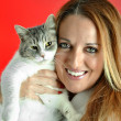 Portrait of pretty woman hugging her cat — Stock Photo #55569261