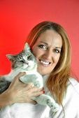 Portrait of pretty woman hugging her cat — Foto Stock