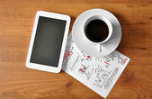 Coffee with digital tablet and analytical paper  — Stock Photo
