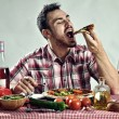 Crazy hungry man eating pizza  — Stock Photo #59428839