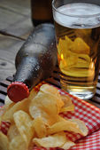 Bottles of cold beer and chips — Stock Photo