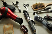 Hairdressing tools on a wooden floor — Stock Photo