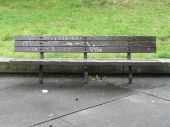Graffitied Park Bench — Stock Photo