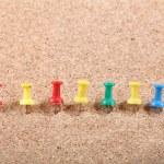 Group of Thumbtacks Pinned on Corkboard — Stock Photo #57150769