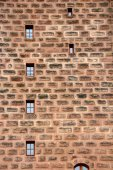 Ancient wall with small windows displayed — Stock Photo
