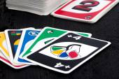 Uno card game on black table — Stock Photo