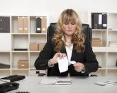 Young businesswoman tearing up a document — Stock Photo