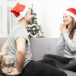 Man surprise girlfriend with christmas gift — Stock Photo #55711035
