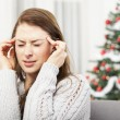 Young girl has headache of christmas stress — Stock Photo #55711407