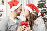 Young couple is happy with gift for christmas — Stock Photo