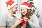 Young couple opens christmas gift box — Stock Photo