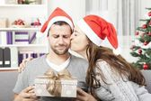 Boyfriend looks skeptical to his christmas gift — Stock Photo